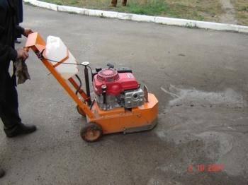 Машина для выравнивания дорожного покрытия БелДТ-4101